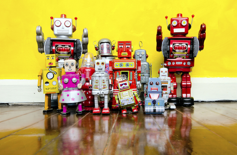retro robot toys on a wooden floor